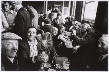 People in Knave of Club's pub, Club Row, London 1976, later print Marketa Luskacova born 1944 Presented by Tate Members 2013 and forming part of Eric and Louise Franck London Collection http://www.tate.org.uk/art/work/P80317